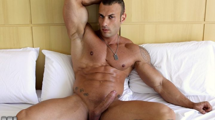 Sicilian big muscle bodybuilder Gianluigi Volti strips naked and jerks his huge muscle cock