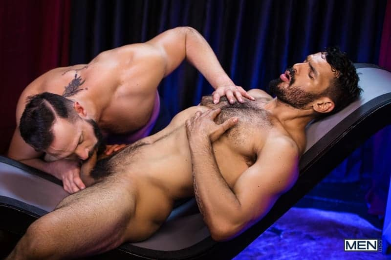 Andy Onassis drops to his knees sucking down hard on muscular hairy stud Jean Franko's big dick